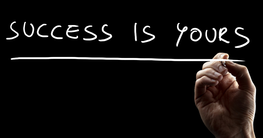 Conceptual close-up of a male hand underlining the motivational quotation affirming that success is yours, on a virtual transparent screen, with copy space on black.